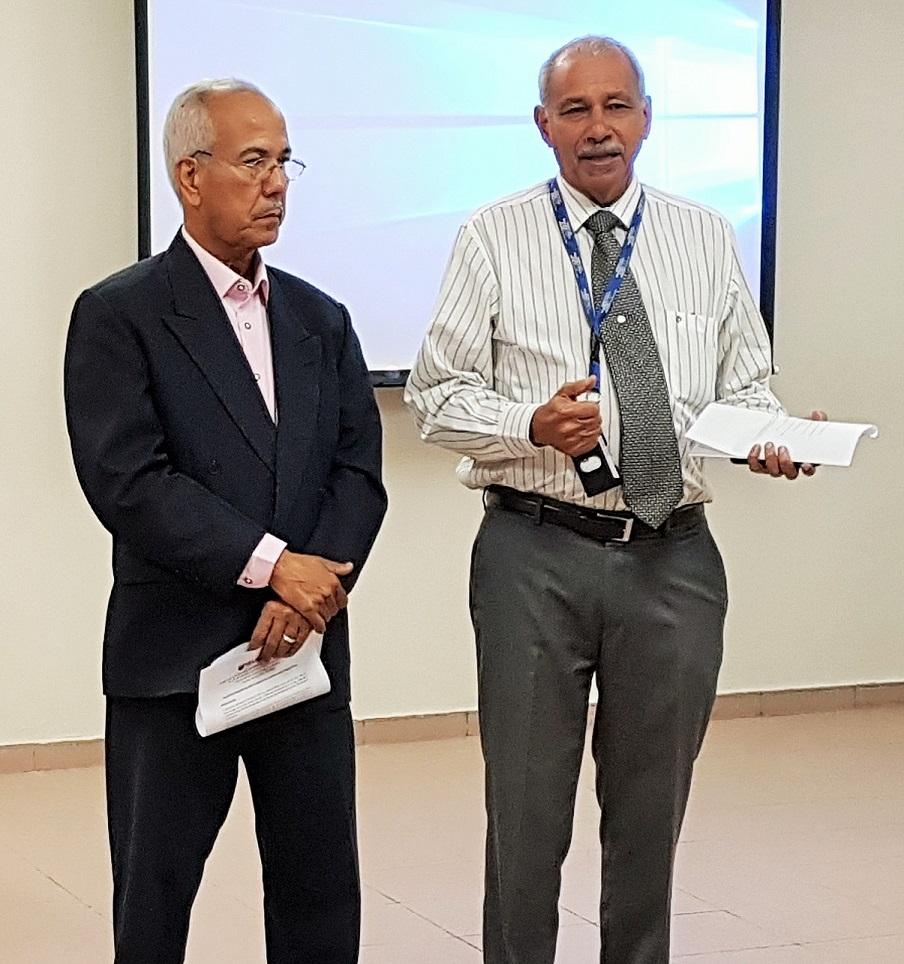 Alfredo Fernández Dotel de la DPCI y el Rector en funciones de UNAPEC, Francisco D´Oleo.